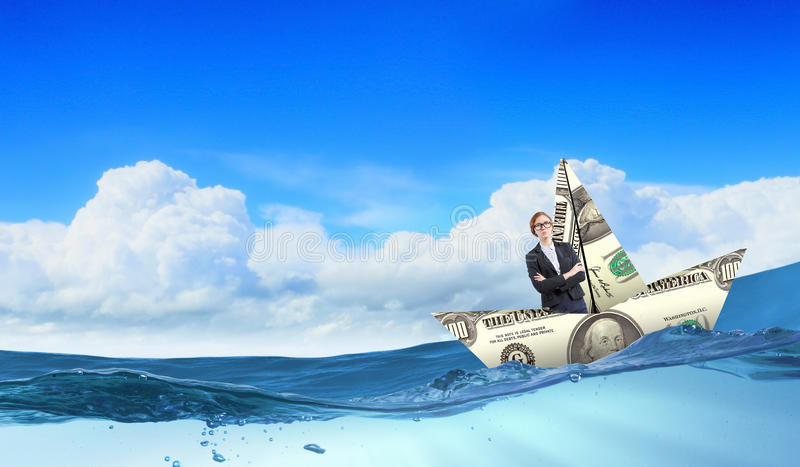 Woman in dollar boat stock photos