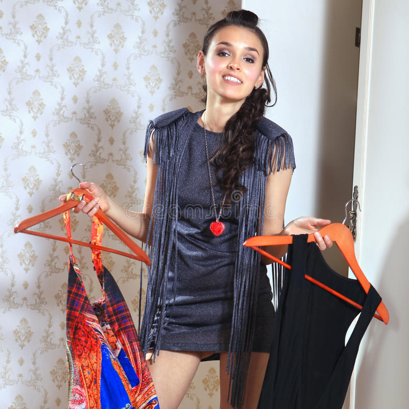 Woman don't know what to wear stock photography