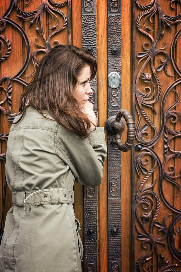 Woman door retro. Forging vintage royalty free stock image