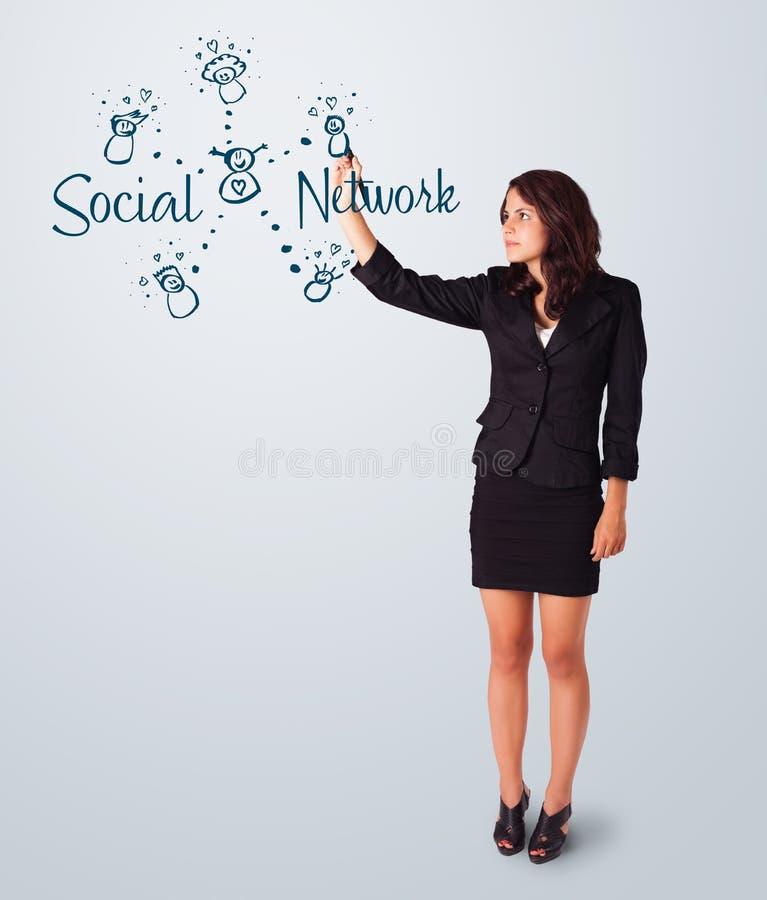 Woman draving social network theme on whiteboard stock photo