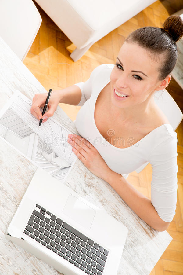 Woman drawing a blueprint stock images