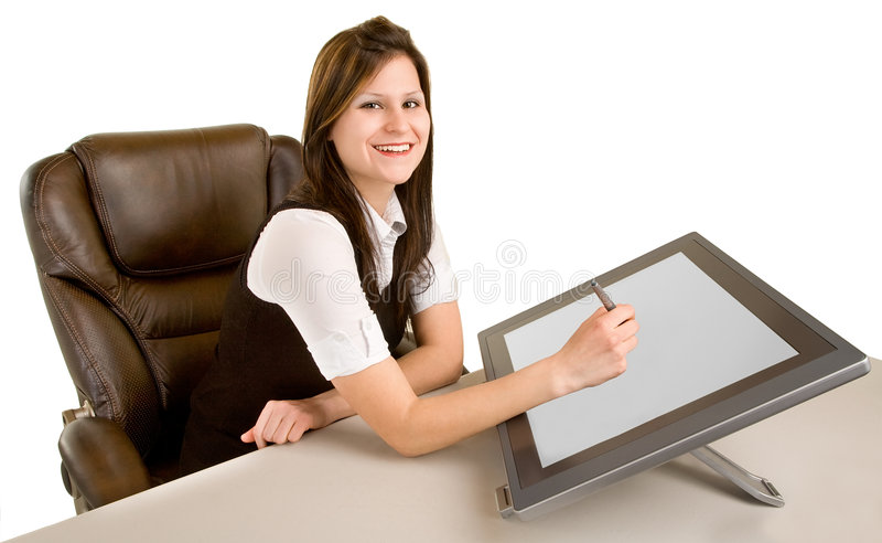 Woman Drawing on a Digital Tablet. A young woman is drawing on a digital tablet stock photos
