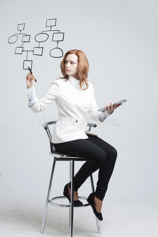 Woman drawing flowchart, business process concept. Businesswoman drawing flowchart, business process concept on grey background royalty free stock image