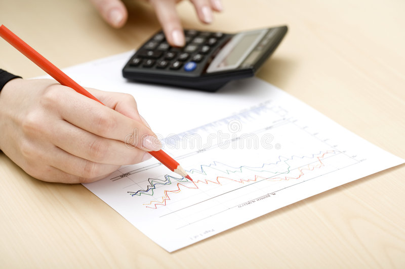 Woman drawing a graph royalty free stock images