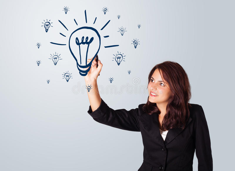 Woman drawing light bulb on whiteboard stock illustration