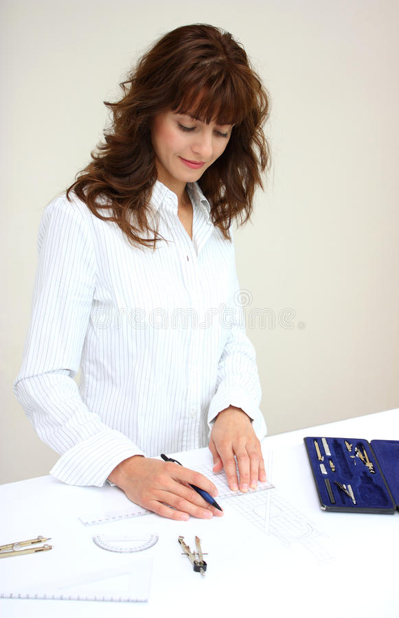 A woman drawing a project royalty free stock photography