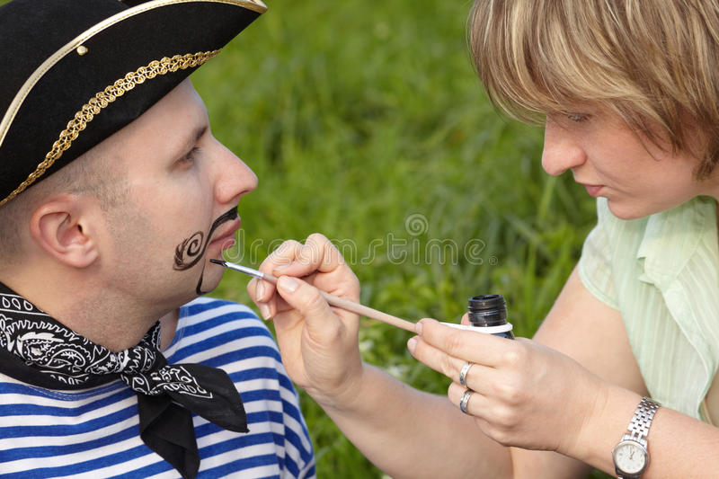Download Woman Drawing Whiskers And Beard On Man's Face Royalty Free Stock Photo - Image: 13020965