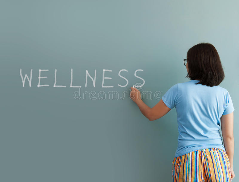 Woman drawing with white chalk on wall stock images