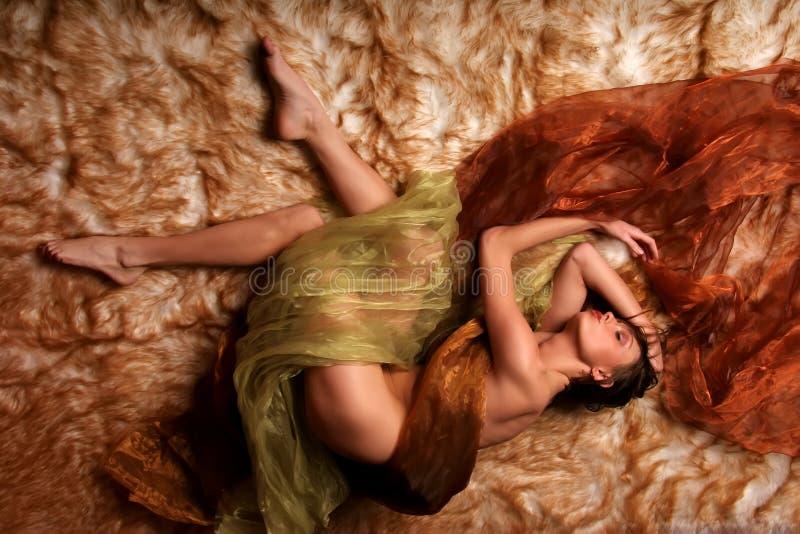 Woman dreaming. Beautiful woman dreaming in her sleep stock image