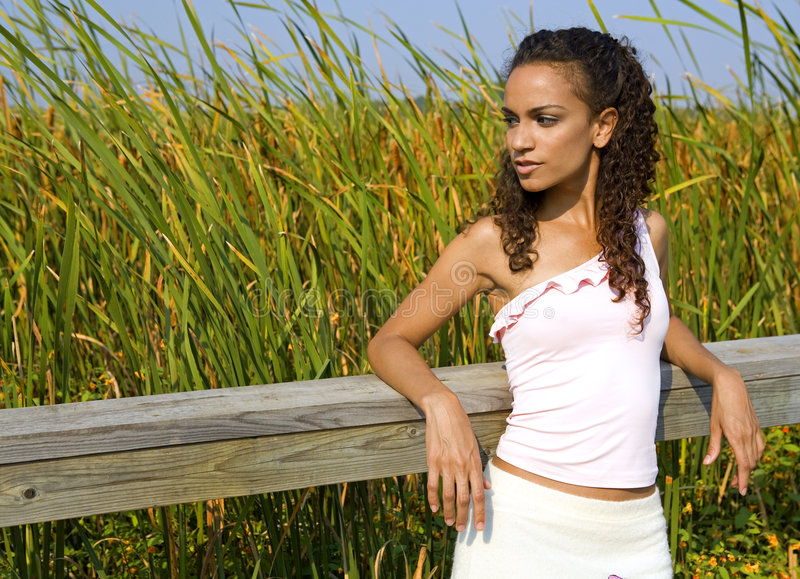 Woman in dress. Brunette posing wearing her white outfit in the fall days stock photos