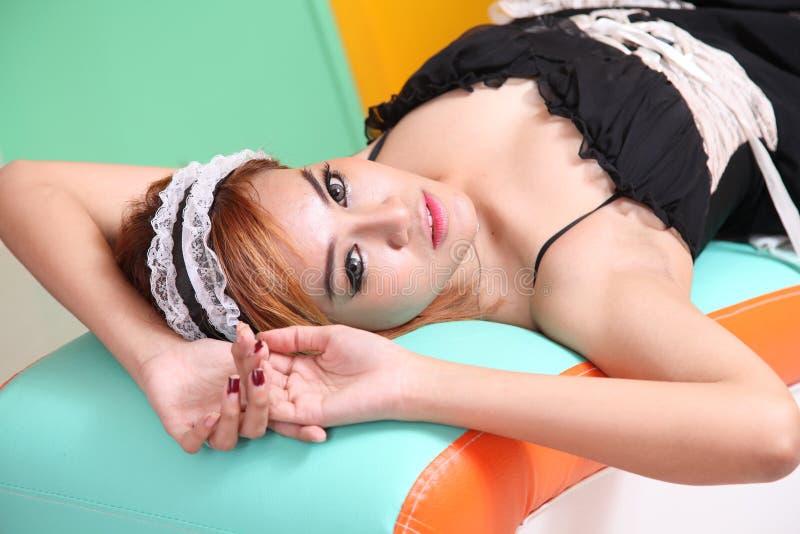 Woman dress as maid stock image