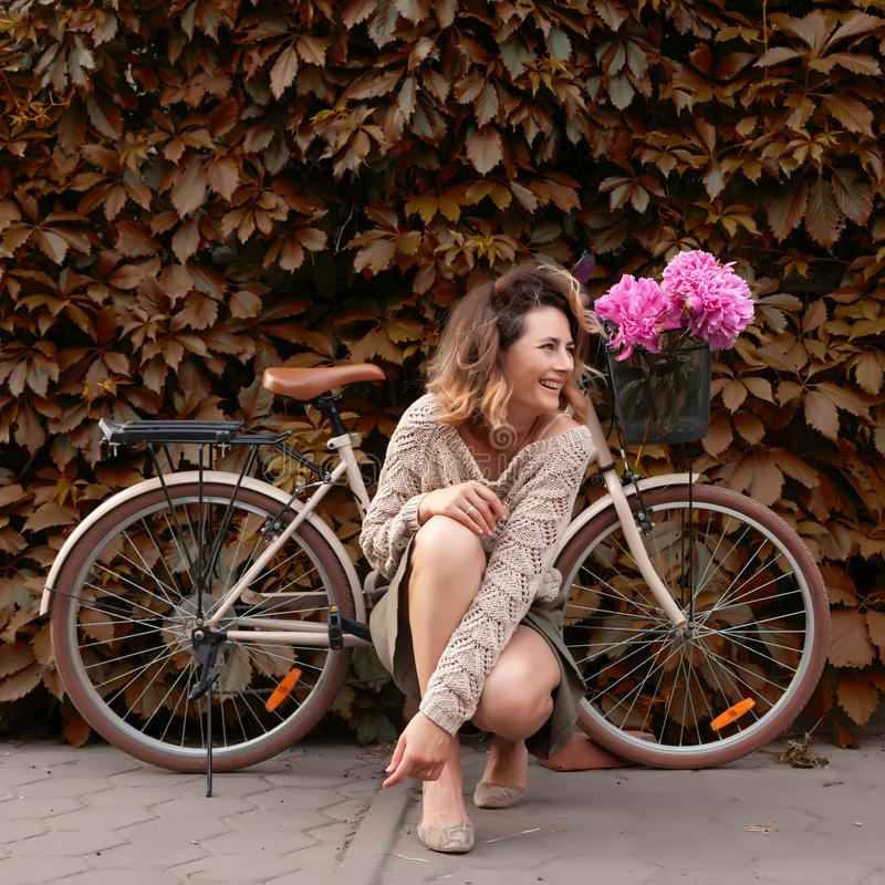 Woman in dress and bike stock image