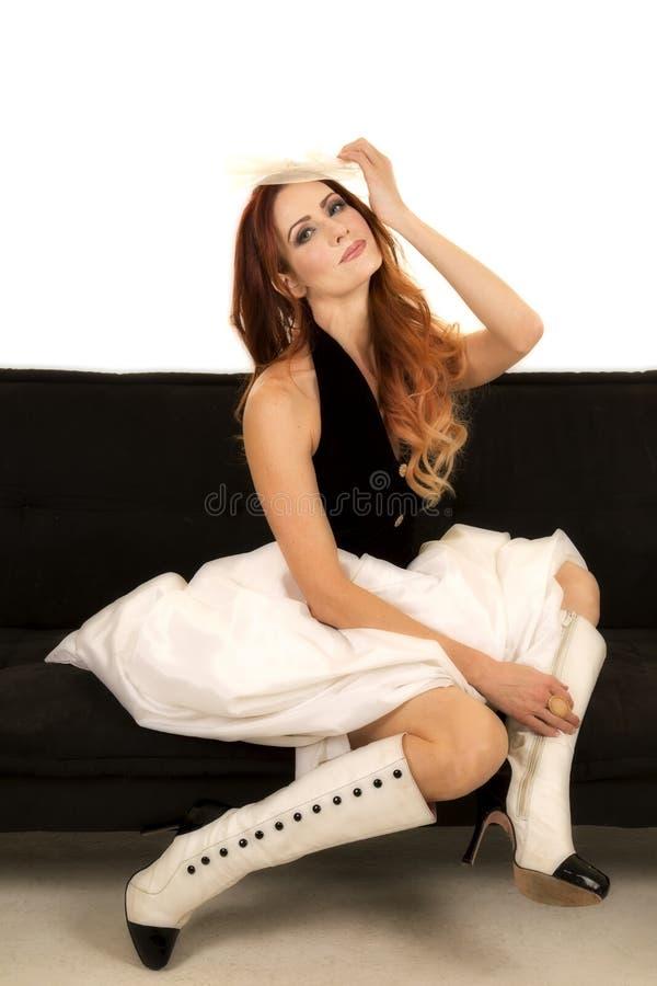 Woman in dress black vest sit sideways stock photography