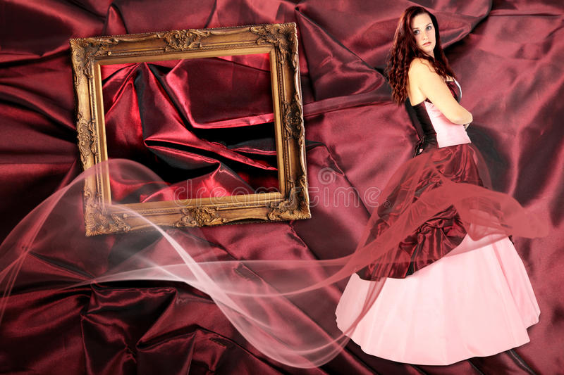 Woman with Dress with crinoline and picture frame royalty free stock photography