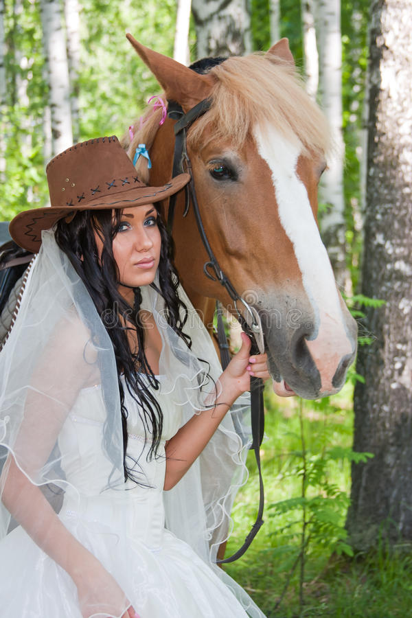 Download Woman In The Dress Of Fiancee Next To A Horse Stock Photo - Image: 28443382