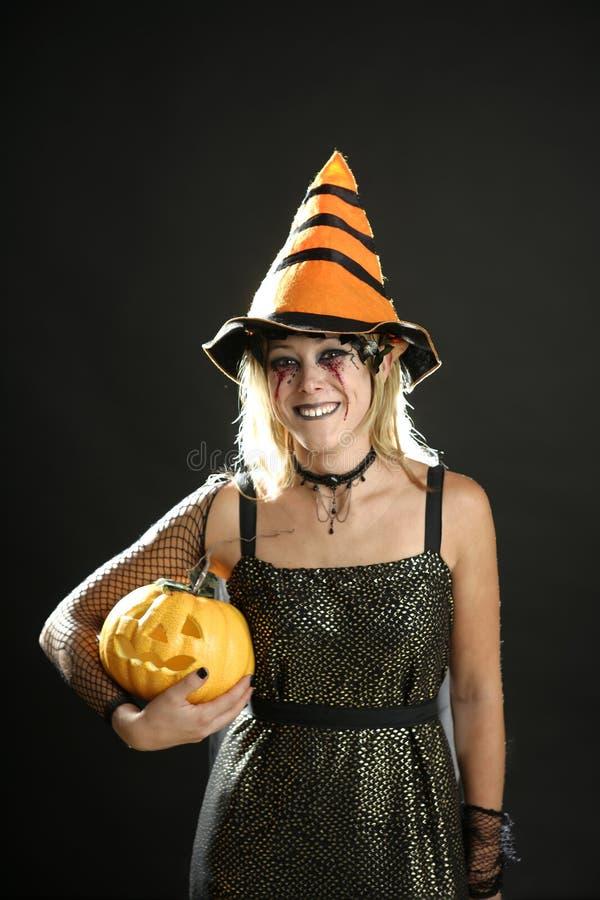 Woman dress for halloween and pumpkin stock photos