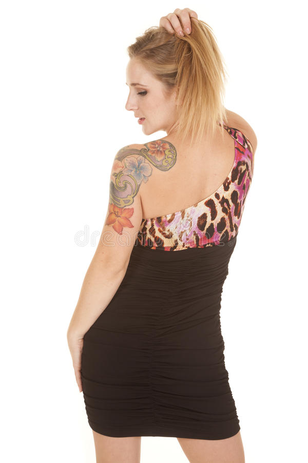 Woman dress off shoulder tattoo back look side stock photos