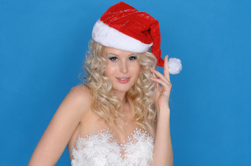 Download Woman In Dress Of Snowflakes And Christmas Hat Stock Image - Image: 22655573