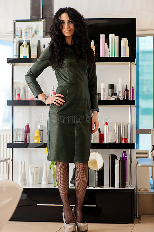 Woman in dress standing in the beauty salon royalty free stock images