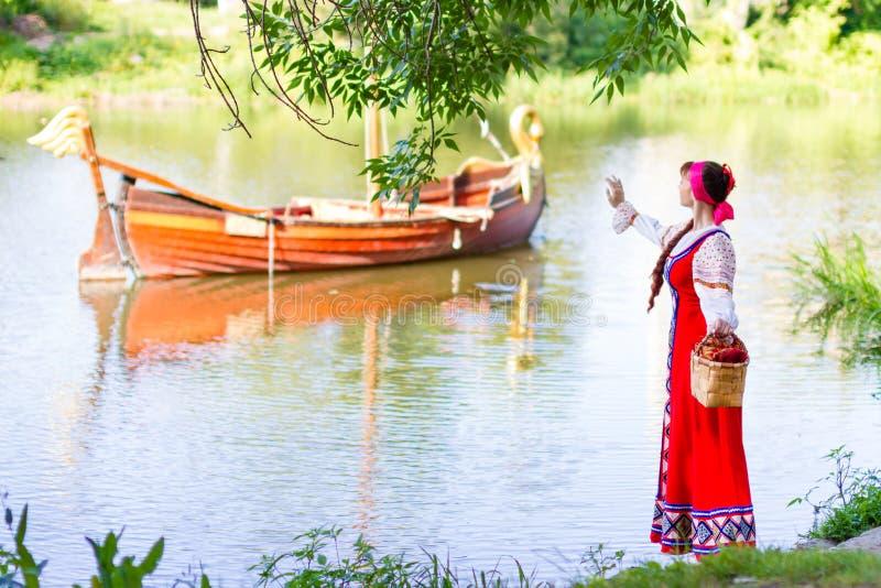 Woman in dress suit stylized Ukrainian folk stock photo