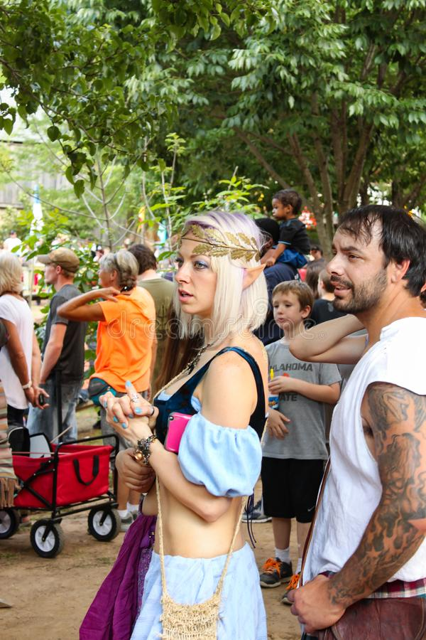 Woman dressed as elf with puple and blond streaked hair in crowd at Renassiance Faire Muskogee Oklahoma 5 21 2016 stock images