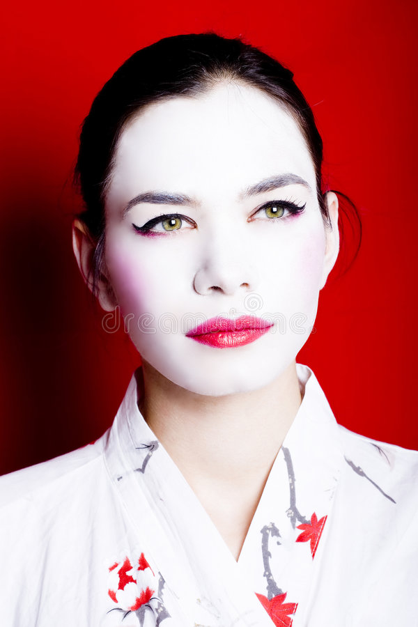 Woman dressed as a geisha royalty free stock photos
