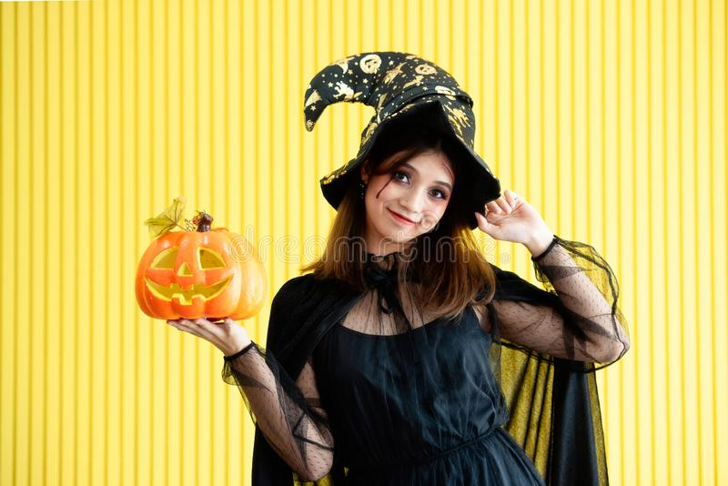 A woman dressed as a witch at Halloween party royalty free stock image