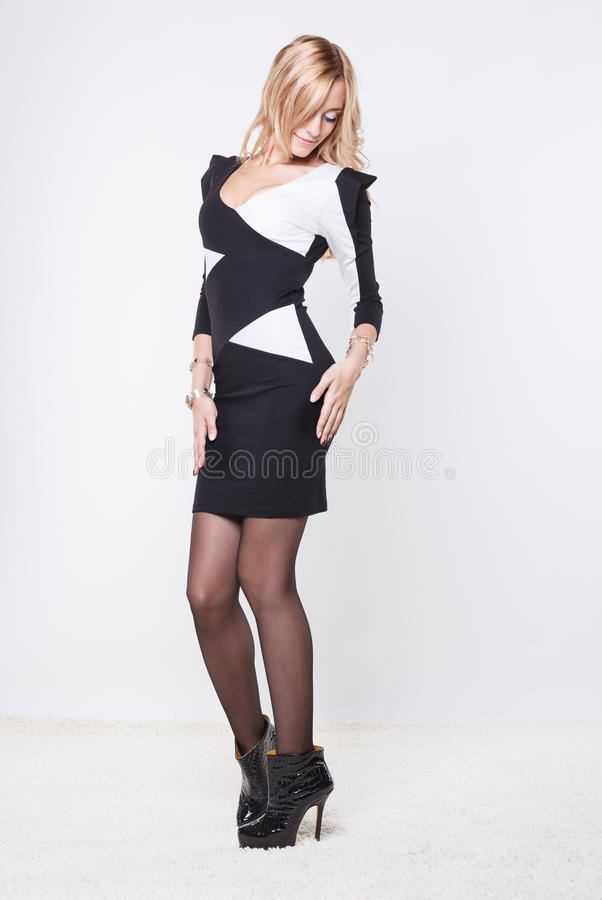 Woman dressed in a black and white dress. stock images