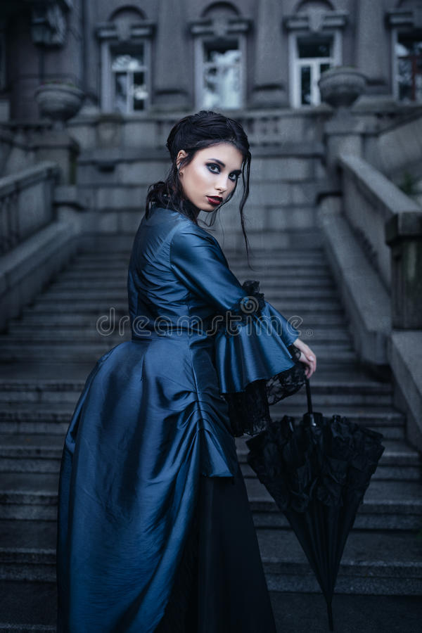 Woman in blue near old building royalty free stock image