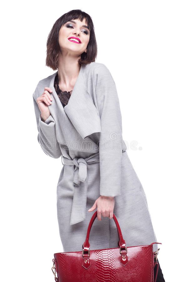 Woman dressed in a gray coat, beautiful smiles royalty free stock photography