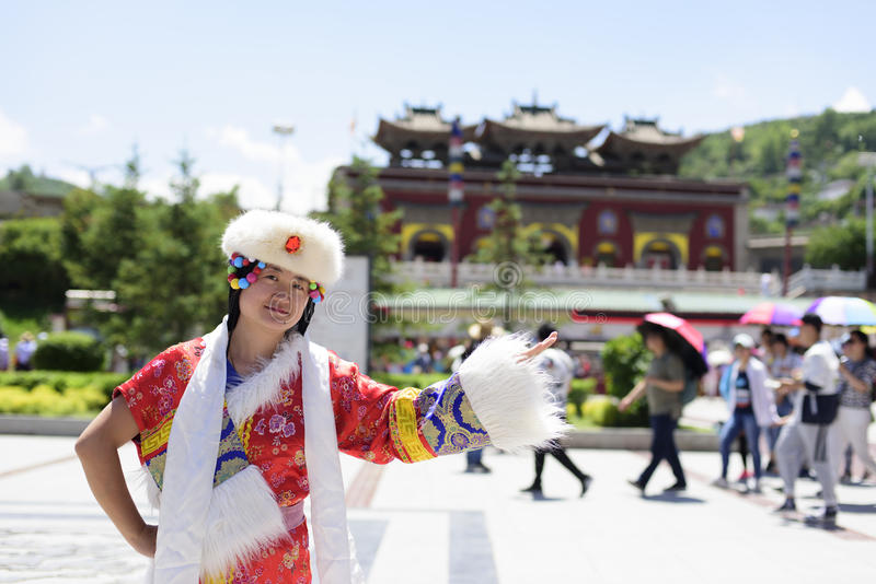 A woman dressed in Tibetan costume royalty free stock photography