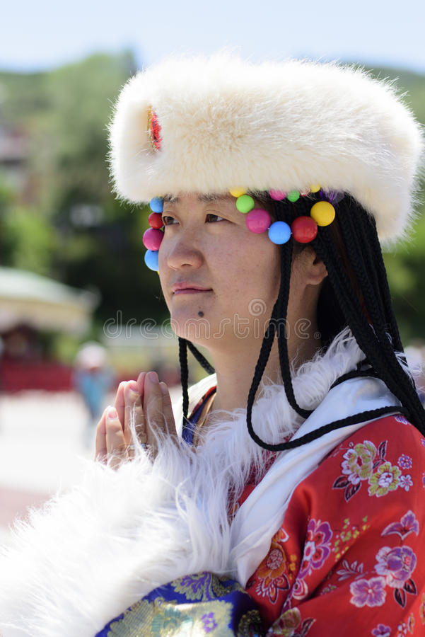 A woman dressed in Tibetan costume stock photo