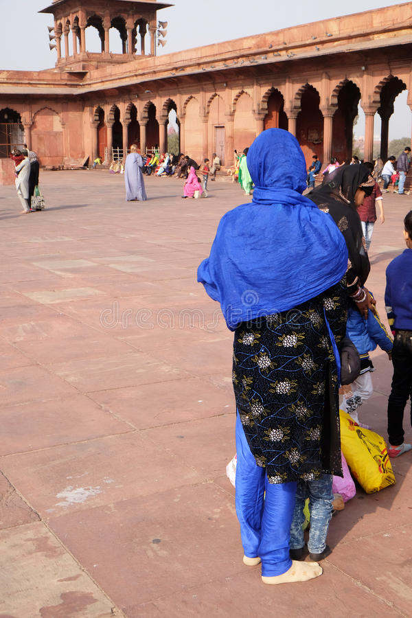 Woman dressed in traditional clothing at Jama Masjid mosque in Delhi stock images