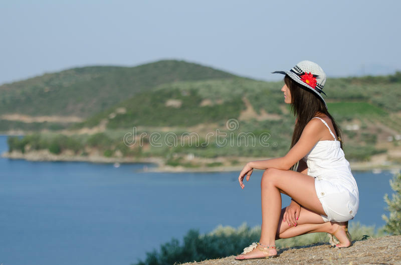 Woman dressed with white coveralls rompers joying the sunny day royalty free stock image