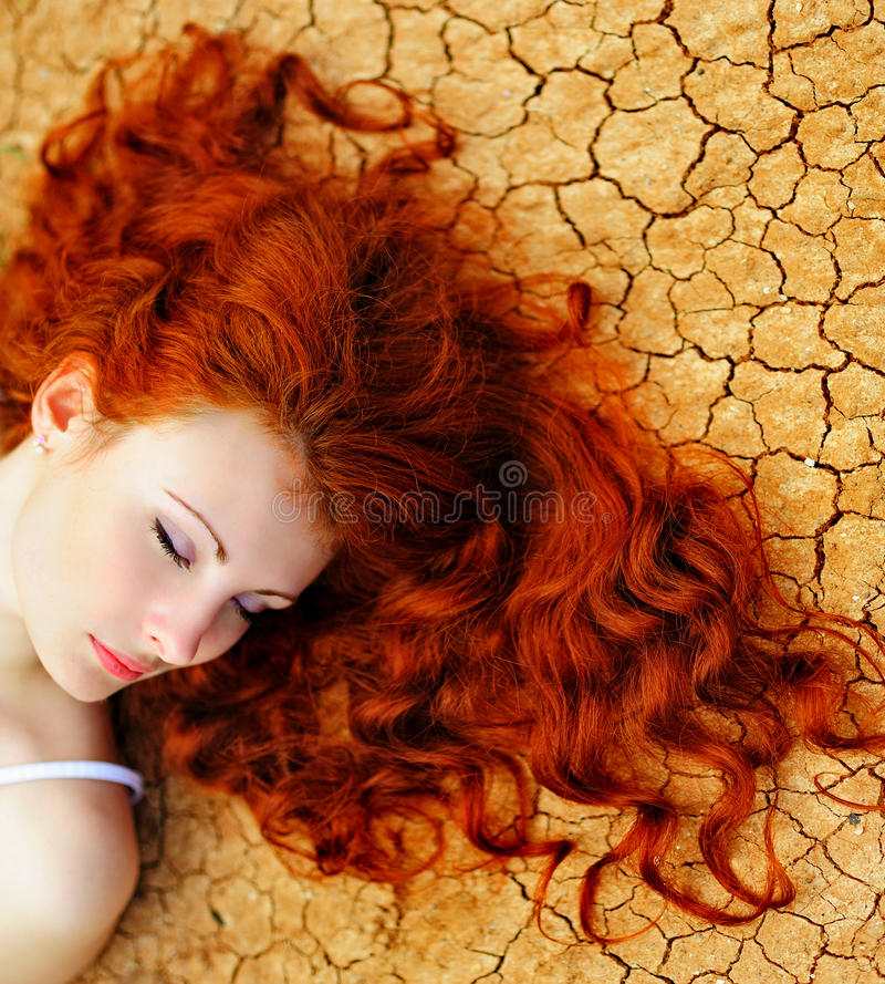 Woman on the dried up ground royalty free stock photos