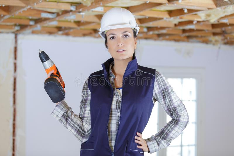 Woman before drilling ceiling royalty free stock photos