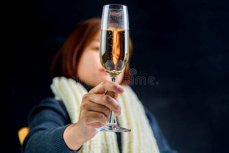 Woman drink champagne stock image