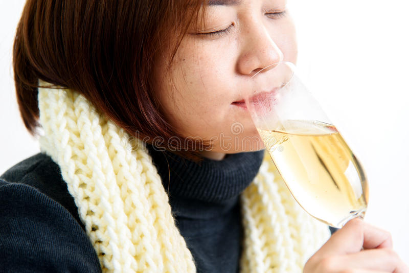 Woman drink champagne royalty free stock photography