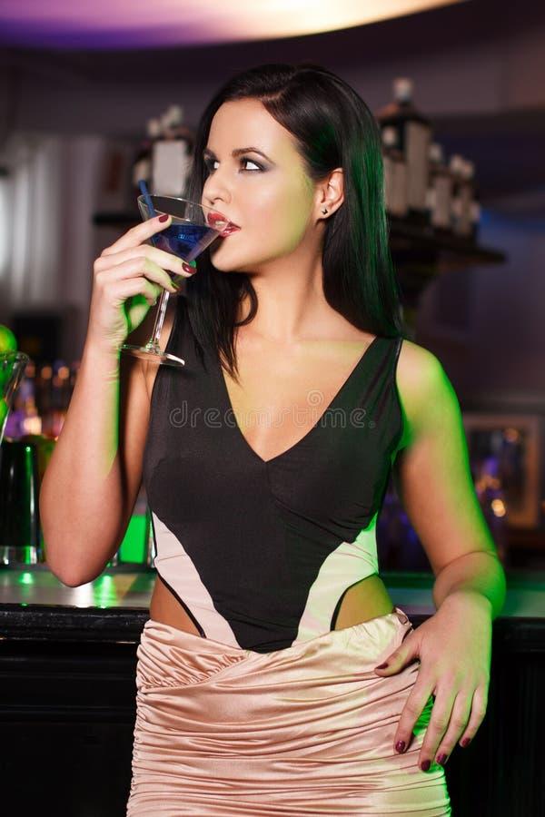 Woman drink martini in bar. Sensual brunette woman drink martini in bar stock photos