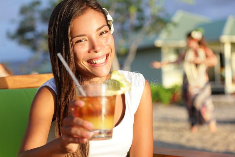 Woman drinking alcohol Mai Tai drink on Hawaii stock photos