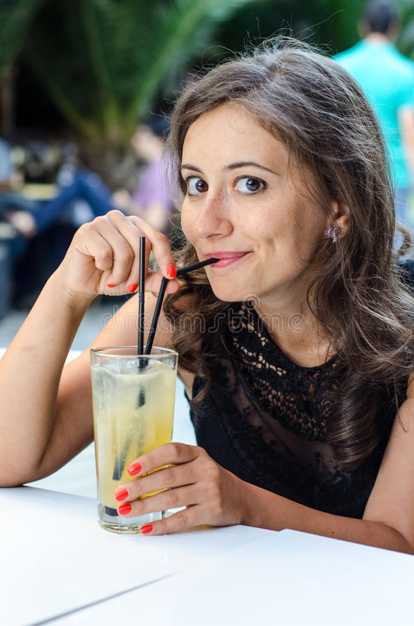 Woman drinking alcohol royalty free stock photography