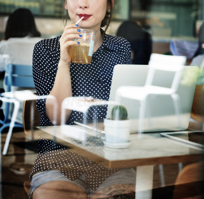Woman Drinking Beverage Digital Tablet Technology Concept stock photos