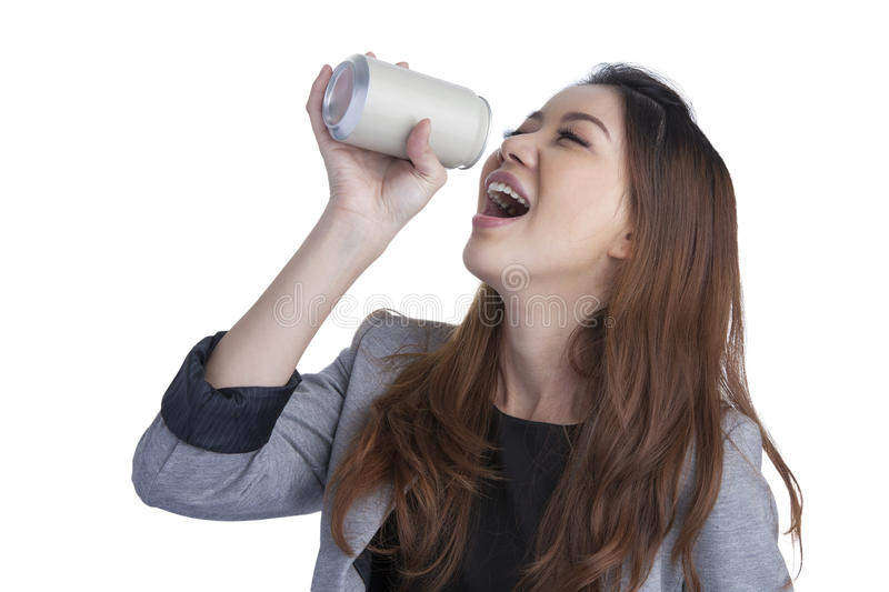 Woman drinking from blank can. Woman drinking / showing blank can. Excited happy screaming girl holding energy drink or other drink. Asian / Caucasian female royalty free stock image
