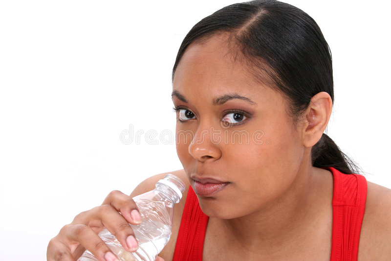 Woman drinking bottled water stock images