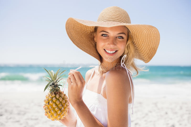 Woman drinking cocktail in pineapple royalty free stock images