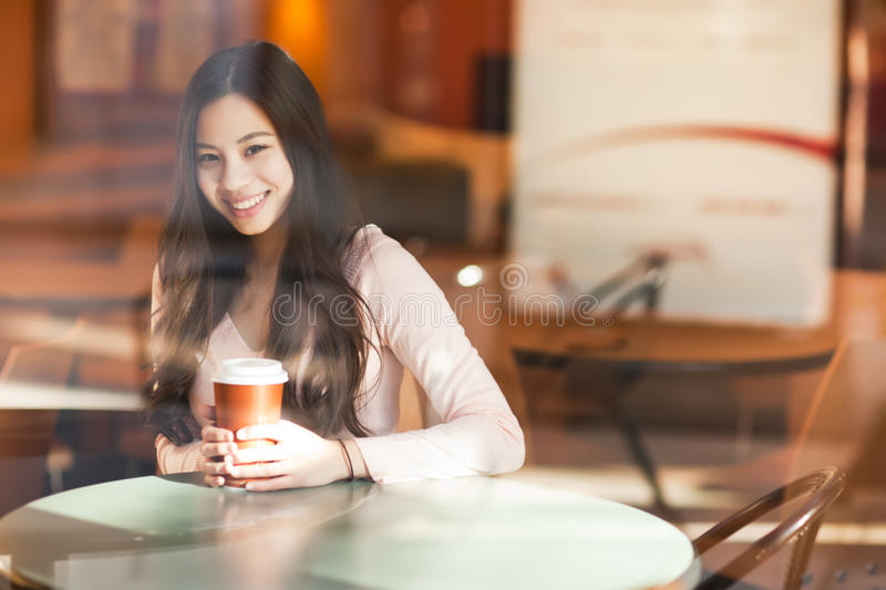 Woman drinking coffee stock photography