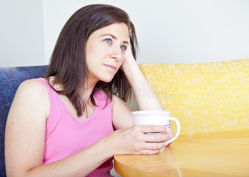 Download Woman drinking coffee stock photo. Image of concerned - 20850702
