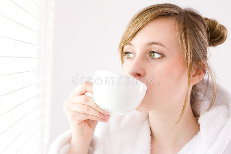 Download Woman drinking coffee stock image. Image of sunlight, bathrobe - 5059019