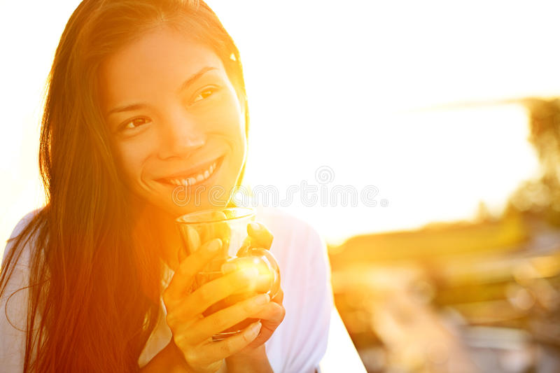 Woman drinking coffee in sunshine royalty free stock images