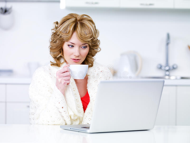 Download Woman Drinking Coffee And Using Laptop Royalty Free Stock Photos - Image: 16690838
